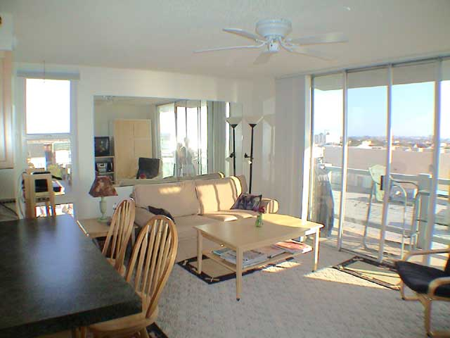 enjoy views of the bay ocean and city lights from this bright living room - The Living Room San Diego